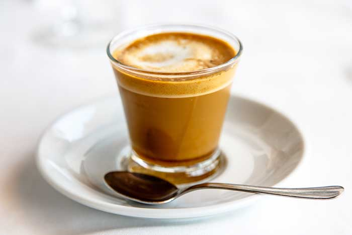 cortado spanish coffee with milk in the cup